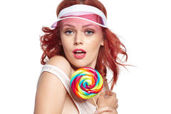 Glamourous girl wearing hat holding lollipop Royalty Free Stock Photos