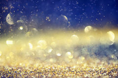 Glamourous luxury golden and blue bokeh background Royalty Free Stock Images