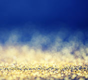 Glamourous luxury golden and blue bokeh background. Magic christmas concept. Text space Stock Images