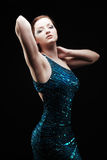 Glamourous woman. Posing in blue sparkly dress stock images