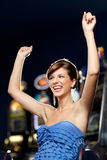 Glamourous woman celebrating winning royalty free stock images