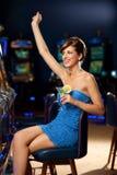 Glamourous woman celebrating winning. Young woman playing celebrating arcade winning Royalty Free Stock Image