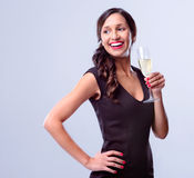 Glamourous woman holding glass of sparkling wine champagne Stock Image