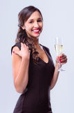 Glamourous woman holding glass of sparkling wine champagne Stock Photo