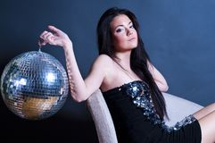 Glamourous young girl with disco ball Stock Photos