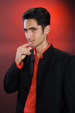 Glamur man in black costume. And red shirt Royalty Free Stock Images