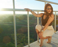 Glamur woman sitting in staircase. With gold sunglasses and watch Royalty Free Stock Images