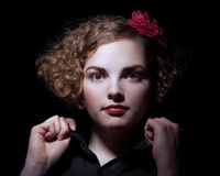 Glance. Pretty with curly hair looking to Royalty Free Stock Photography