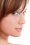 Glance. Close-up portrait of pretty girl looking over her shoulder and smiling Royalty Free Stock Photos