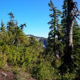 A glance of another mountain peak from top of Cypress provincial park. From this view could see the snow reflecting the sunshine in summer time stock photo