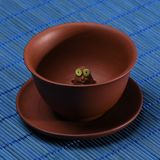 Glance from a clay cup. Cup on a blue mat royalty free stock images