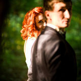 glance of the redhead bride next to the groom Stock Images