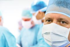Glance of the surgeon in the operating room. Glance of the mature surgeon in the operating room royalty free stock photos