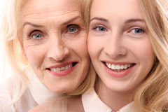 Glances of happy smiling female persons. Joyful different aged women are looking at camera with happiness in their eyes. Portrait Stock Photo