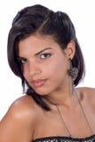 Glances. Portrait of a teenage deep eyes, wearing dark earrings Royalty Free Stock Images