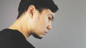 Glancing. An asian man with black t-shirt royalty free stock photography