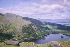 Glanmore lake at Healy Pass, a 12 km route worth of hairpin turns winding through the borderlands of County Cork and County Kerry Stock Image