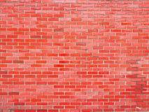 Glansig vägg för röd tegelsten Arkivfoto