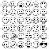 glansiga emoticons Arkivbild