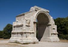 Glanum - la San-Remy-de-Provenza: L'arco trionfale Fotografia Stock Libera da Diritti
