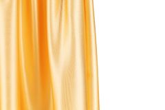 Glanzend zijde oranje gordijn Stock Foto's