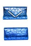 Glanzende blauwe koppeling op een witte achtergrond stock foto's