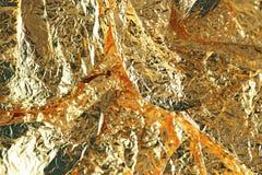 Glanzende gele gouden folieachtergrond Gouden metaalachtergrond stock foto