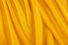 Glanzende gele stof Royalty-vrije Stock Afbeeldingen