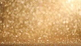 Glanzende gouden lichtenachtergrond stock videobeelden