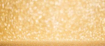 Glanzende gouden lichtenachtergrond Stock Afbeeldingen