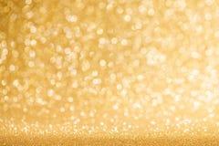Glanzende gouden lichtenachtergrond Royalty-vrije Stock Afbeelding
