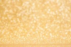 Glanzende gouden lichtenachtergrond Royalty-vrije Stock Afbeeldingen
