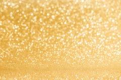 Glanzende gouden lichtenachtergrond Stock Foto's