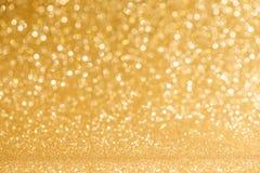 Glanzende gouden lichtenachtergrond Stock Afbeelding