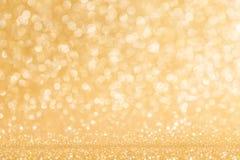 Glanzende gouden lichtenachtergrond Royalty-vrije Stock Foto