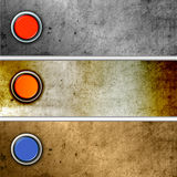Glanzende knopen op metaalachtergronden Stock Afbeeldingen