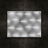 Glanzende metaalplaat op grungemetaal Royalty-vrije Stock Afbeeldingen