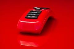 Glanzende rode plastic afstandsbediening Stock Fotografie