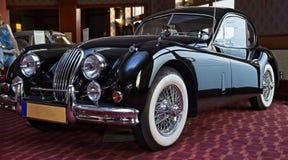Glanzende zwarte uitstekende sportwagen royalty-vrije stock foto