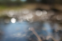 Glare bokeh in water. In sunny spring day Royalty Free Stock Images