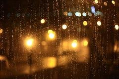 Glare bokeh on wet window Stock Photo