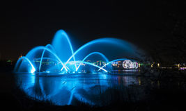 Glare fountain. Fountains add a charming color to the city at night Stock Image
