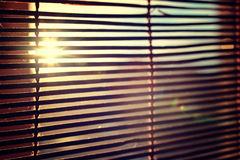 Glare From Bright Sunlight Through The Wooden Rom Blinds Royalty Free Stock Photo