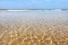Glare of the sun in the shallow waters of the sea in the summer. Soft focus, selective focus stock image