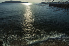 The glare of the Sun on the water beautiful waves. Beautiful sun spots are on sea water, reflections in the waves Royalty Free Stock Image