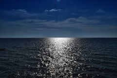 Glare of the sun and the waves on the sea. The Glare of the sun and the waves on the sea Stock Photo