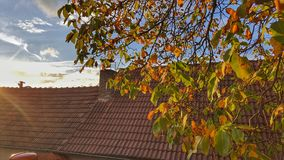 Glaring Fall from the Attic. Attic view in sunny Autumn, Czechia stock photography
