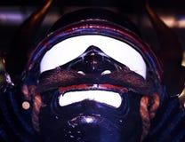 Glaring mask. Historic mask with glaring eyes and mask, angled upward. Fairly Royalty Free Stock Photo