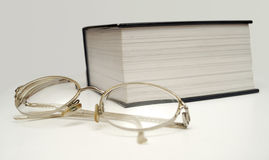GLAS AND BIG BOOK II Stock Photography