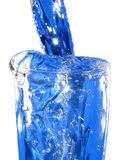 A glas of blue water. Frozen image of a glas of blue water Royalty Free Stock Photo